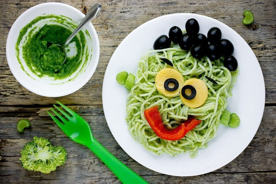 Frankeinstein meal with zucchini pasta and olives and pesto